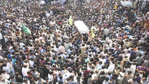Karachi begins burials amid sobs, unrest
