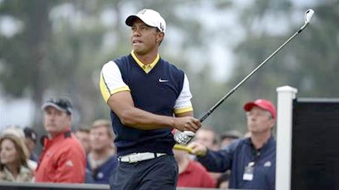 Tiger says McIlroy should choose words more carefully