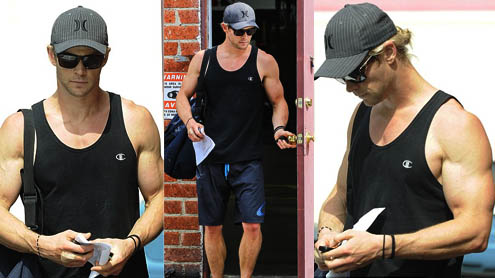 Chris Hemsworth shows off his bulging biceps as he leaves the gym