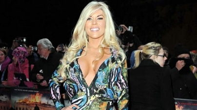Frankie Essex shows off Ample Chest in  Garish Gown at Olympus Has Fallen Premiere