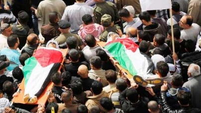 Funerals draw thousands in tense W. Bank