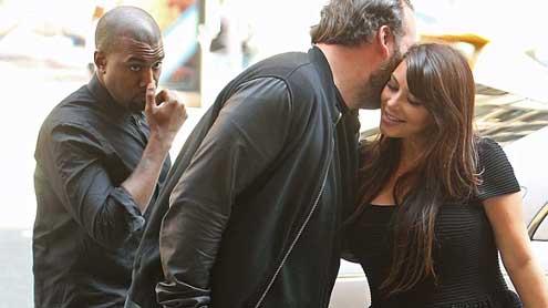 Kanye West's blood boils as a pal kisseshis pregnant girlfriend Kim Kardashian