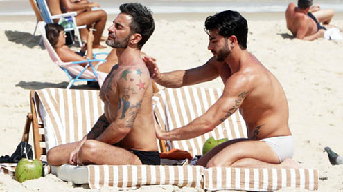 Marc Jacobs and porn star beau Harry Louis show off their buff bodies on the beach