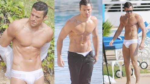 Mark Wright shows off his toned body as he poses in tight white pants