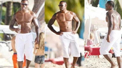 Tyson Beckford shows off his impressive muscles as he hits the beach in Barbados