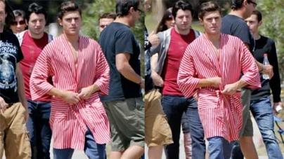 Zac Efron reveals his super toned chest in a striped robe