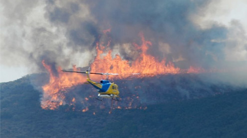 Nearly uncontrollable California wildfire grows, threatens 4,000 homes