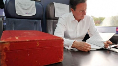 Did Cameron leave his red box on a train unattended?