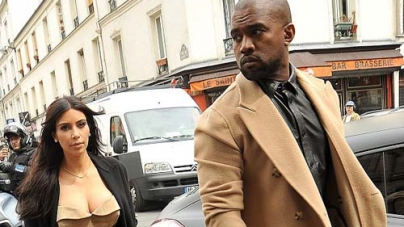Kim Kardashian Kanye West hit Shops Matching Camel Coloured Outfits