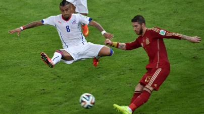 Chile Win to Send Champions Spain Home