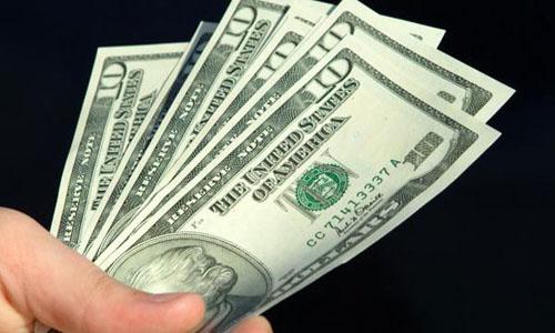 Dollar gains on upbeat