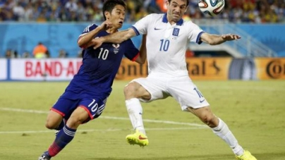 Ten-man Greece Hold Japan to Goalless Draw