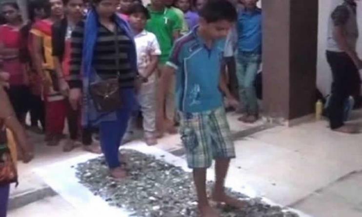 Indian students walk barefoot on broken glass