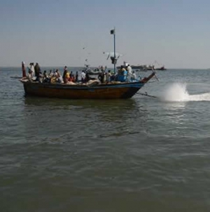 Indian Navy takes boat away from Pakistani waters