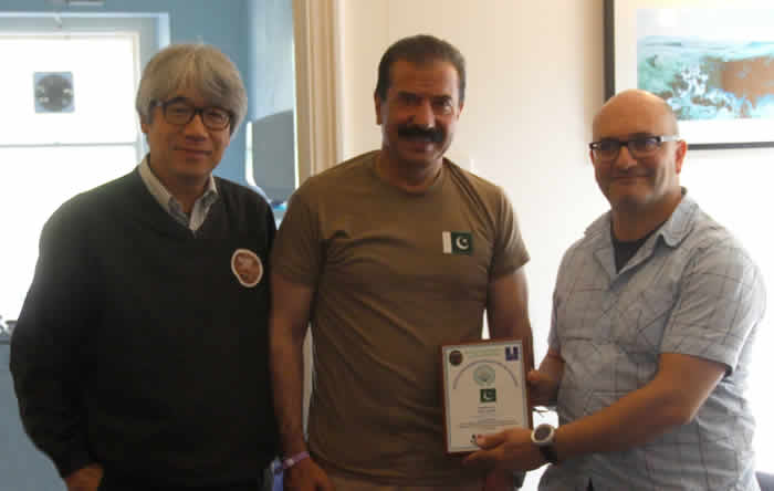 Hayatullah Khan Durrani presenting commemorative shield to Secretary of European Speleo Congress Damian Waere