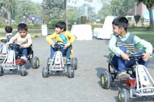 Kids in the pedal car area at Fitness Fiesta