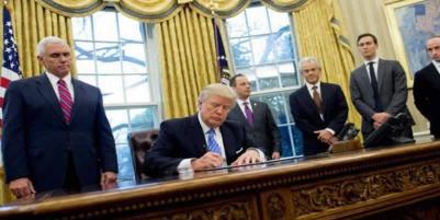 Trump Revises Travel Ban, Exempts Iraqis