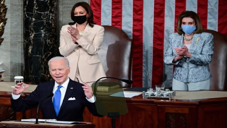 Biden tells Congress US 'moving forward' amid pandemic