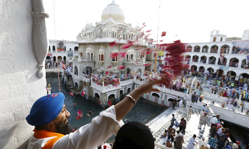 A Sikh devotee throws flower