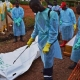Ebola workers in Sierra Leone Dump Bodies