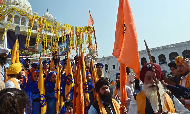 Priests march at the Gurdwara