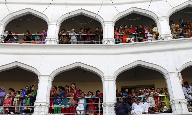 Sikh devotees watch the Baisakhi festival at Panja Sahib