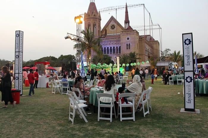 swing against the backdrop of Frere Hall